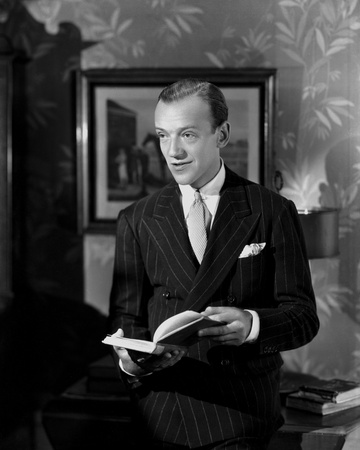 Fred Astaire Holding a Book in Black and White Photo by  Movie Star News