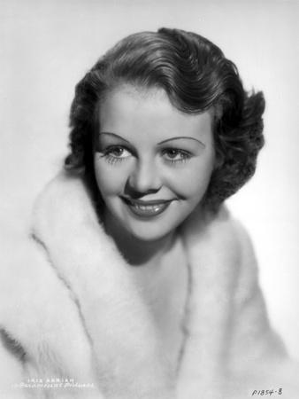 Iris Adrian smiling in Classic Portrait Photo by  Movie Star News