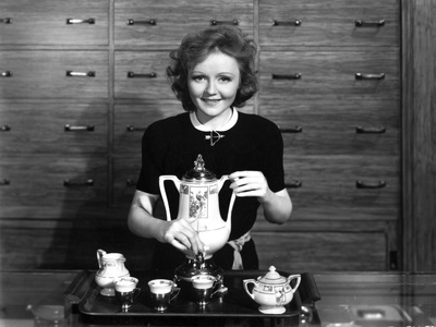 Nancy Carroll Holding Tea Pot in Classic Photo by  Movie Star News