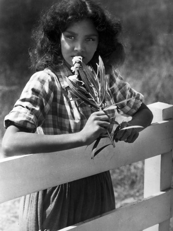 Jennifer Jones on Checkered Top Leaning Photo by  Movie Star News