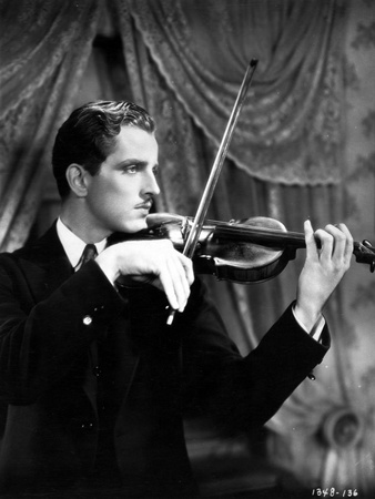 Phillip Holmes Playing Violin in Classic Photo by  Movie Star News