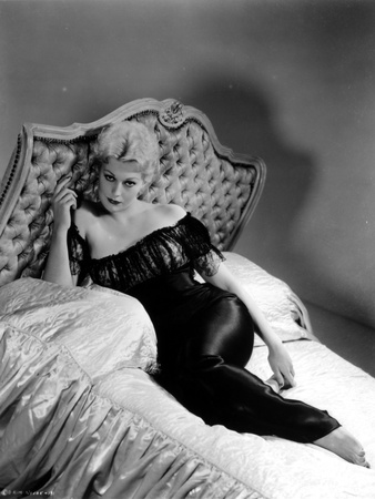 Kim Novak Lying on Bed in Black Gown Photo by  Movie Star News