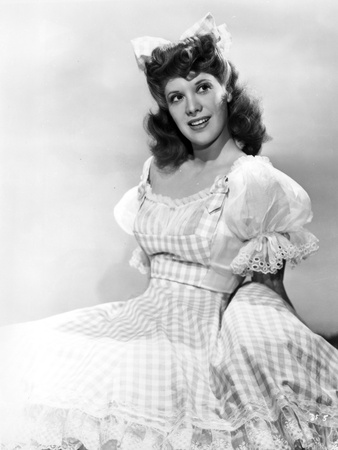 Dinah Shore Reclining in Plaid Dress Photo by  Movie Star News