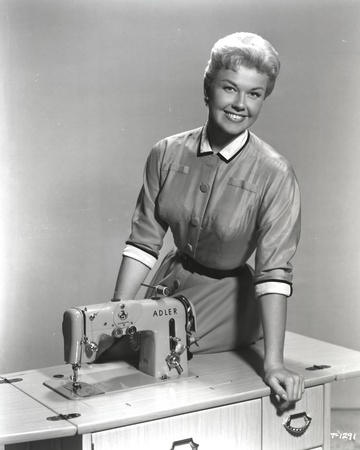 Doris Day Seated in Sewing Machine Photo by  Movie Star News