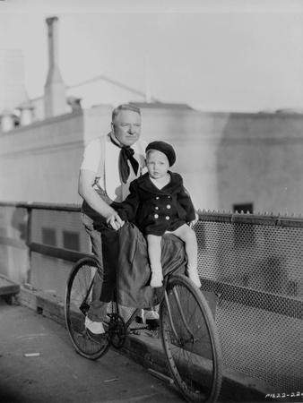 W C Fields Riding on Bicycle with a Boy Photo by  Movie Star News