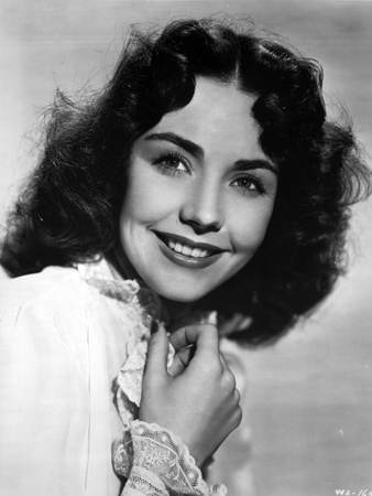 Jennifer Jones posed and Smiling Photo by  Movie Star News