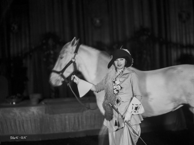 Greta Garbo Holding a White Horse Photo by Bert Longworth