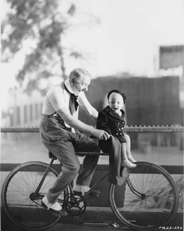 W C Fields Riding on a Bicycle Photo by  Movie Star News