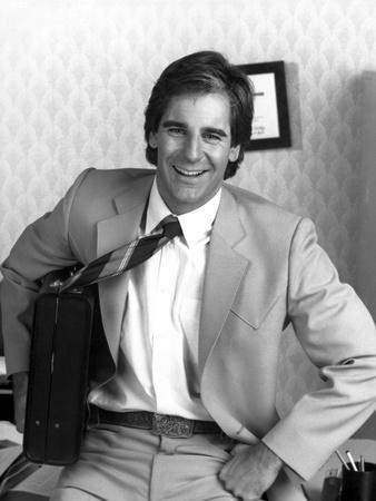Scott Bakula sitting in Suit Photo by  Movie Star News