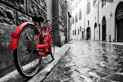 Retro Vintage Red Bike on Cobblestone Street in the Old Town. Color in Black and White. Old Charmin Photographic Print by PHOTOCREO Michal Bednarek