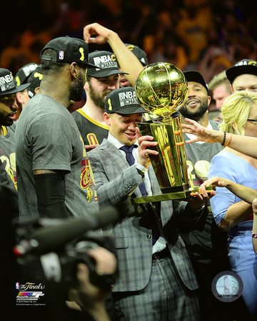 Tyronn Lue with the NBA Championship Trophy Game 7 of the 2016 NBA Finals Photo