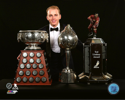 Patrick Kane with the 2016 Art Ross and Hart trophies & the Ted Lindsay Award Photo
