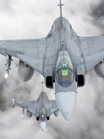 A Pair of Hungarian Air Force Jas-39 Gripen over Lithuania Photographic Print by  Stocktrek Images