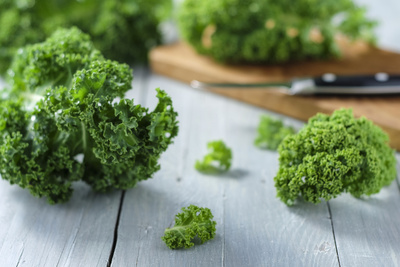 Fresh Kale on Gray Wooden Table Photographic Print by Jana Ihle