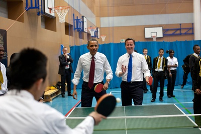 Barack Obama and BPmMinister David Cameron Play Table Tennis with Globe Academy Students in London Photo