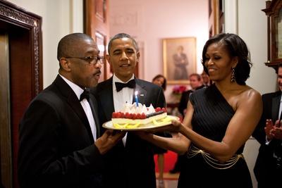 President Barack Obama and Michelle Obama Present a Birthday Cake to Assistant Usher Reggie Dickson Photo