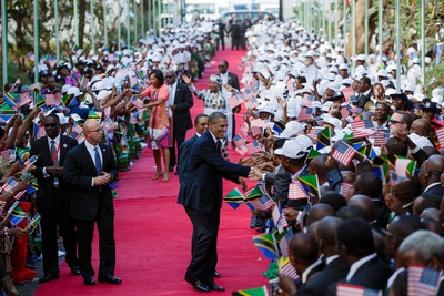 President Barack Obama and First Lady Michelle Obama Shake Hands with the Tanzanian Crowd Photo