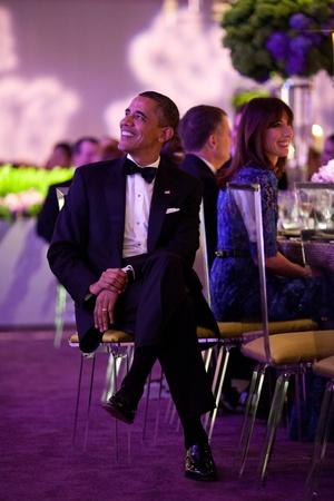 President Barack Obama Listens as British Prime Minister David Cameron at State Dinner Photo