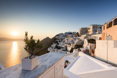 Sunset over the Aegean Sea Seen from a Terrace of the Typical Greek Village of Firostefani Photographic Print by Roberto Moiola