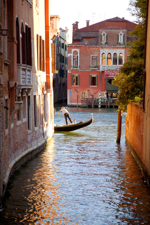 Italy, Veneto, Venice. a Gondolier Rowing His Gondola on the Grand Canal. Unesco Photographic Print by Ken Scicluna