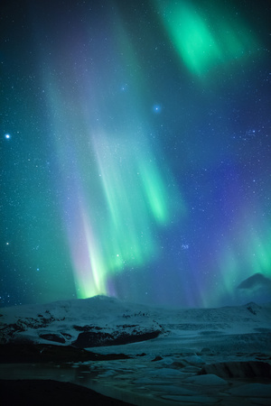 Iceland, Fjallsarlon. the Northern Lights Appearing in the Sky at Fjallsarlon Photographic Print by Katie Garrod