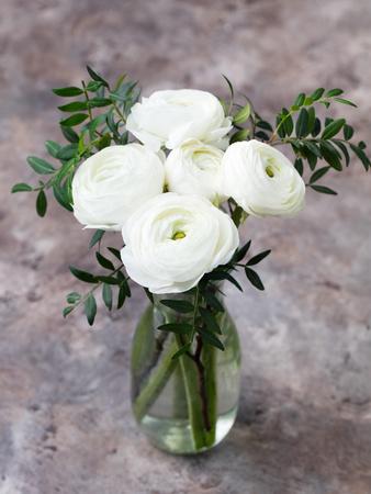 White Ranunculus Flowers in Vase Grey Background Photographic Print by Anna Pustynnikova