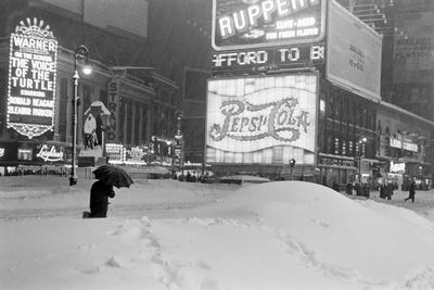 Pedestrians Walking Through Heavy Snow at Night in New York City, December 26-27, 1947 Photographic Print by Al Fenn