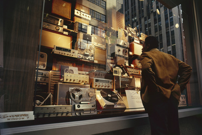 Man Looks at a Window Display of an Electronics Store, New York, New York, 1963 Photographic Print by Yale Joel