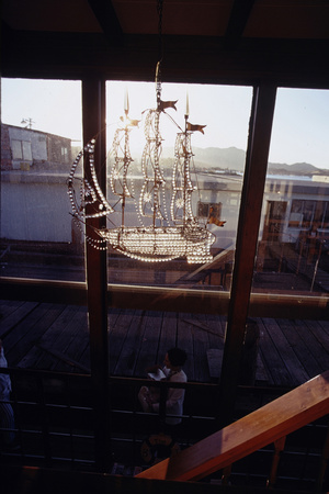 Glass Suncatcher, in the Form of a Three-Masted Ship, in Floating Home, Sausalito, CA, 1971 Photographic Print by Michael Rougier