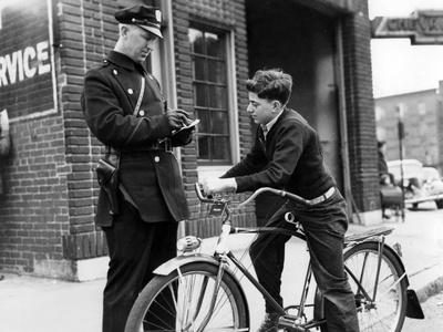Policeman Controls a Cyclist in America, 1938 Photographic Print by Scherl Süddeutsche Zeitung Photo