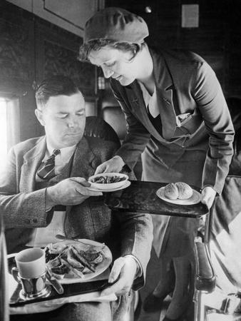 Stewardess Serving Dinner Aboard an Airplane, 1932 Photographic Print by Scherl Süddeutsche Zeitung Photo