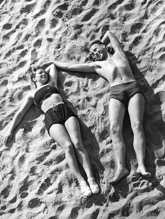 Young Couple Sunbathing, 1939 Photographic Print by  Süddeutsche Zeitung Photo