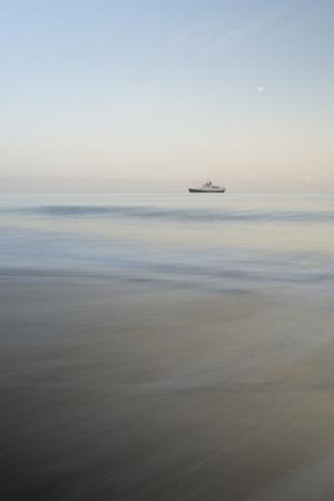 A Ship at Sunrise Along the Coast of Santiago Island, Galapagos Islands, Ecuador Photographic Print by Jeff Mauritzen