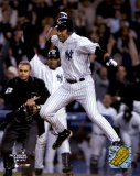 Derek Jeter celebrating after scoring winning run of 2004 ALDS game 2 ©Photofile Photo