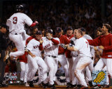 Pokey Reese jumping on plate scoring Game 3 - 2004 ALDS winning run against Angels ©Photofile Photo