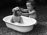 Baby Siblings Taking a Bath Photographic Print by  Bettmann