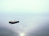 A Dock Appears to Hover in Mid-Air on the Placid Waters of Lake Thun Photographic Print by Jodi Cobb