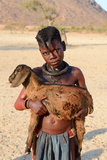 Himba Girl With Traditional Double Plait Hairstyle, Carrying A Goat Photographic Print by Eric Baccega