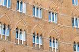 Europe, Italy, Siena. Detail of Arches Building Facades Il Campo Reproduction photographique par Trish Drury