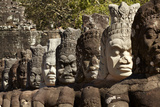 Row of Statues of Asuras on South Gate Bridge across Moat to Angkor Thom, Siem Reap Photographic Print by David Wall