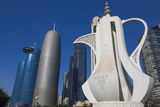 Qatar, Doha, Doha Bay, West Bay Skyscrapers, Morning, with Large Coffeepot Sculpture Photographic Print by Walter Bibikow