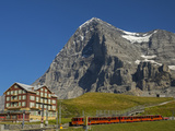 Switzerland, Bern Canton, Kleine Scheidegg, Jungfraubahn Train and the Eiger North Face Photographic Print by Jamie And Judy Wild