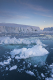 Greenland, Disko Bay, Ilulissat, Floating Ice at Sunset with Moonrise Photographic Print by Walter Bibikow