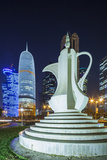 Qatar, Doha, Doha Bay, West Bay Skyscrapers, Dusk, with Large Coffeepot Sculpture Photographic Print by Walter Bibikow