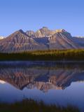 Canada, Alberta, Banff National Park, Sunrise Light on the Bow Range Reflects in Herbert Lake Photographic Print by John Barger