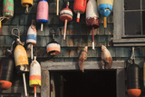 Maine, Bass Harbor, Lobster Buoys on a Building at Bass Harbor Photographic Print by Joanne Wells