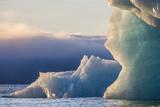 Norway, Svalbard, Kvitoya. Iceberg and Fog Bank at Sunrise Photographic Print by Jaynes Gallery