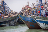 Africa, Western Sahara, Dakhla. Group of Rusting and Aged Fishing Boats Photographic Print by Alida Latham