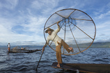 Myanmar, Inle Lake. Young Fisherman Demonstrates a Traditional Rowing Technique Reproduction photographique par Brenda Tharp