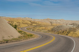Road Swings Through the Badlands National Park, South Dakota, Usa Photographic Print by Michael Runkel